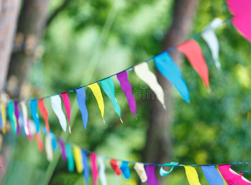 Colorful triangles in the summer park. birthday, party decor stock images