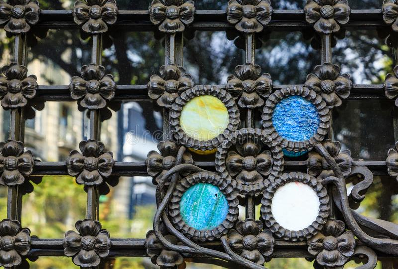 Colorful Trim on Wrought Iron Fence. Ornate Colorful Trim on Wrought Iron Fence stock image