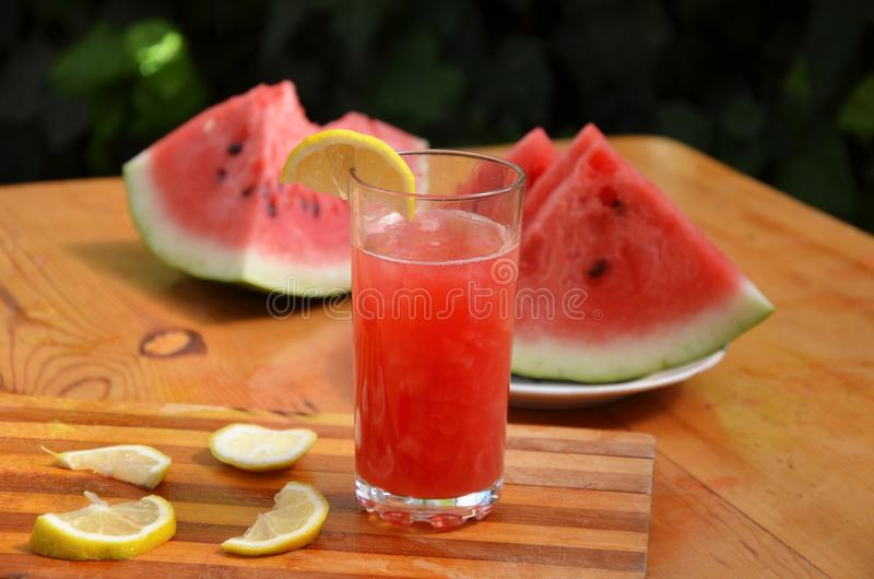 Colorful tropical fresh watermelon smoothie summer drinks in the glasses on wood table background. Refreshing watermelon royalty free stock photo