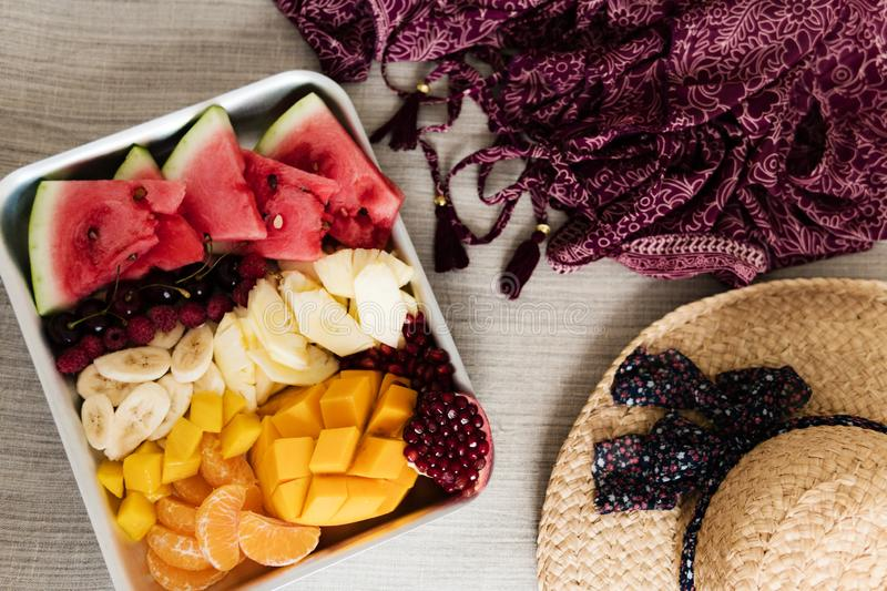 Colorful tropical fruits on serving tray. Summer healthy diet, vegan breakfast.  royalty free stock photo