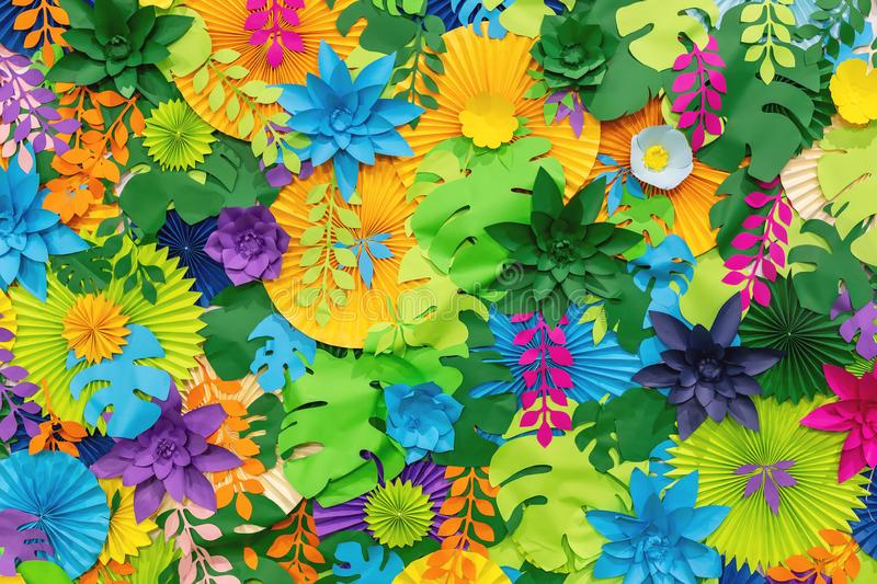 Colorful tropical paper flower background. multicolored Flowers and leaves made of paper royalty free stock image