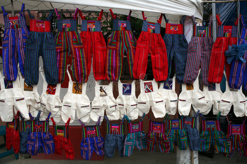 Colorful trousers on city market stock image