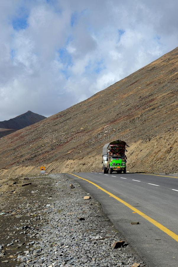 Colorful truck on Karakoram Highway amid mountains Babusar Pass Pakistan royalty free stock image