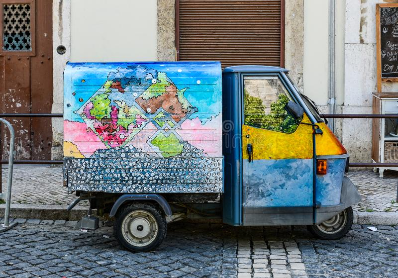 Colorful tuk-tuk in stationary Lisbon, Portugal. stock photography