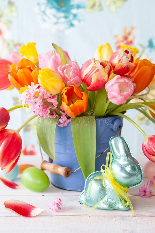 Colorful tulips in little vintage bucket. Colorful spring flowers in a little vintage bucket stock photography