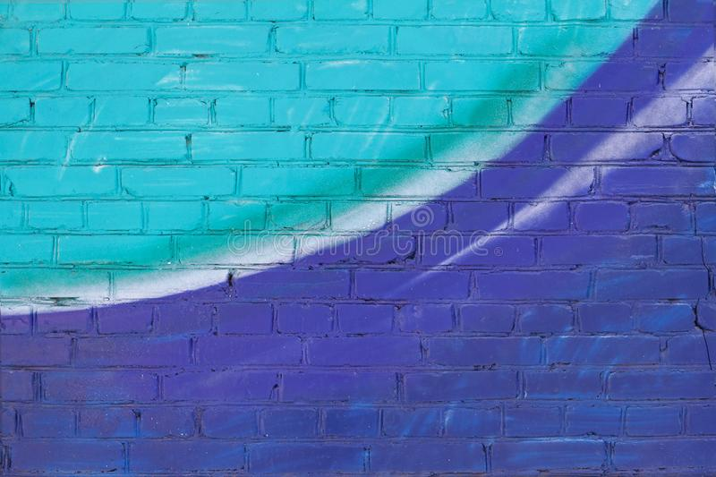 Colorful turquoise, violet and white painted brick wall royalty free stock photography