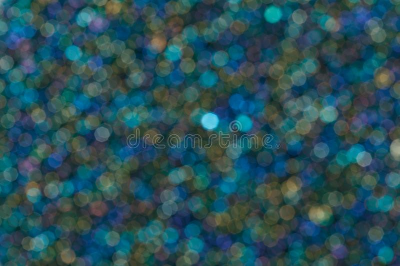 Colorful twinkling lights bokeh blue light background. Close up of colorful twinkling lights bokeh light background. High resolution photo royalty free stock photo