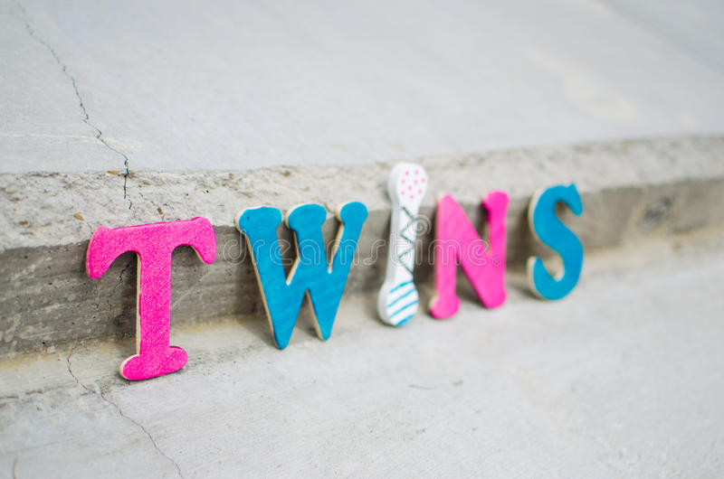 Colorful Twins Text On Pavement Stock Photo