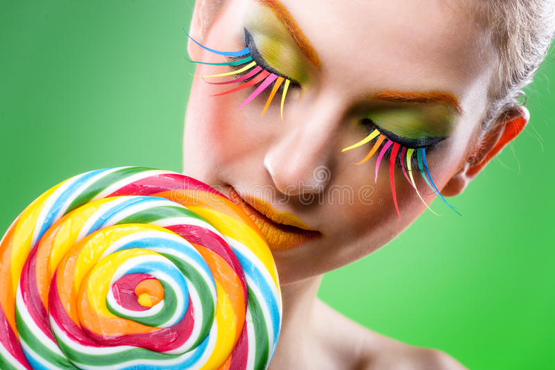 Colorful twisted lollipop, colorful fashion makeup stock photo