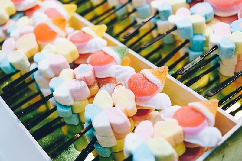 Colorful twisted marshmallows sticks, colorful sugar snacks for eating. Colorful twisted marshmallows sticks, colorful sugar snacks for eating, eat and health royalty free stock image