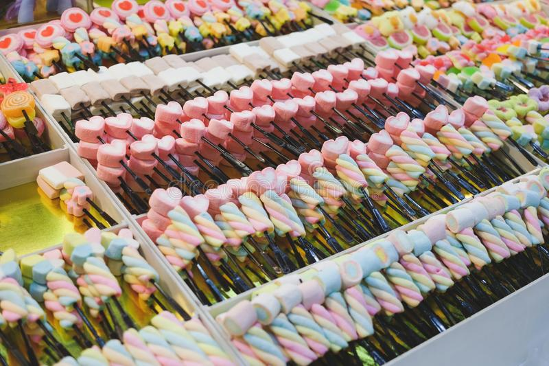 Colorful twisted marshmallows sticks, colorful sugar snacks for eating. Colorful twisted marshmallows sticks, colorful sugar snacks for eating, eat and health royalty free stock photo