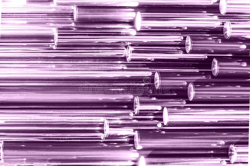 Colorful ultra violet holographic metallic tube as texture. Iridescent wallpaper. Metal surface, trendy design. Abstract stock photography