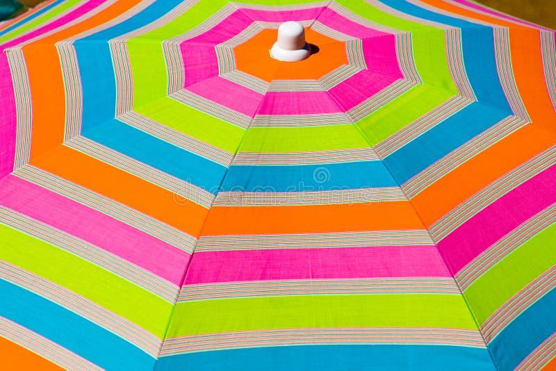 Colorful umbrella on the beach royalty free stock photos