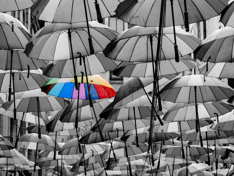 Colorful Umbrella Among Others Different From The Crowd stock images