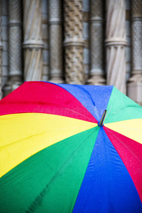 Colorful umbrella on a rainy day in London England royalty free stock image