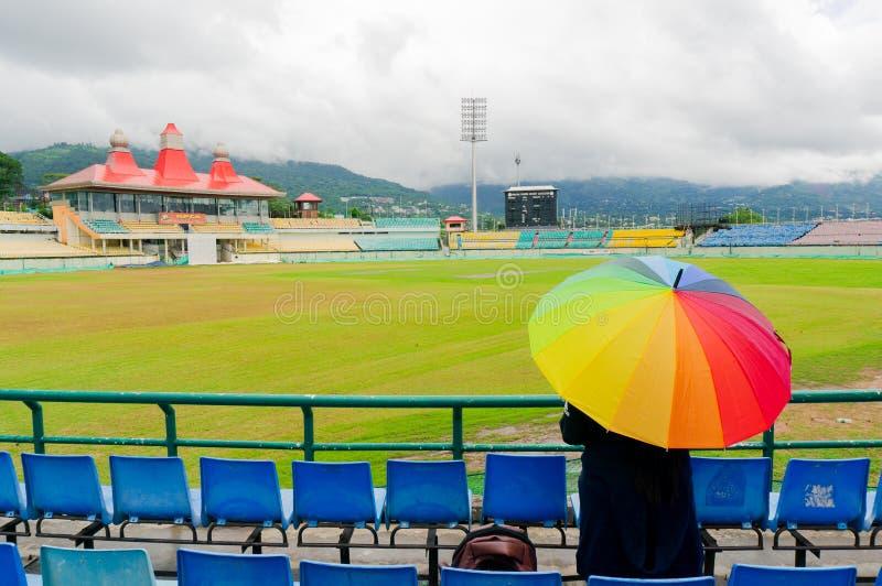 Colorful umbrella on the seats of Dharamshala himachal cricket stadium royalty free stock photo