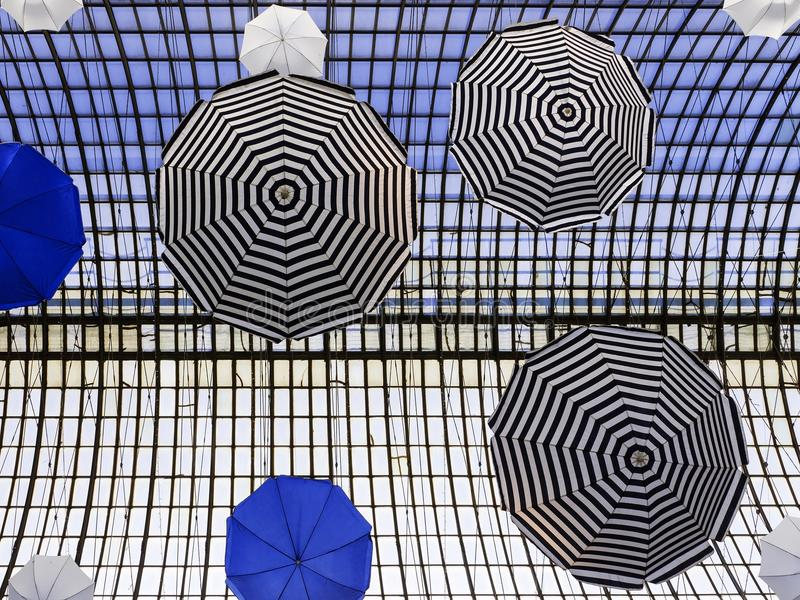 Colorful umbrellas (arch design in the building).  royalty free stock photos