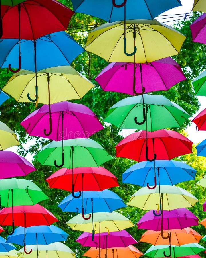 Colorful umbrellas background. Colorful umbrellas in the sky as decoration royalty free stock photo