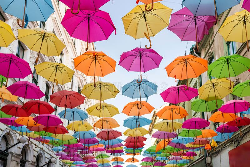 Colorful umbrellas decoration covers the city street stock photos