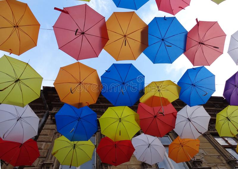 Colorful umbrellas of decoration on a street. Description: Street decoration with colorful umbrellas on the Metianu pedestrian street in Arad, Romania royalty free stock images