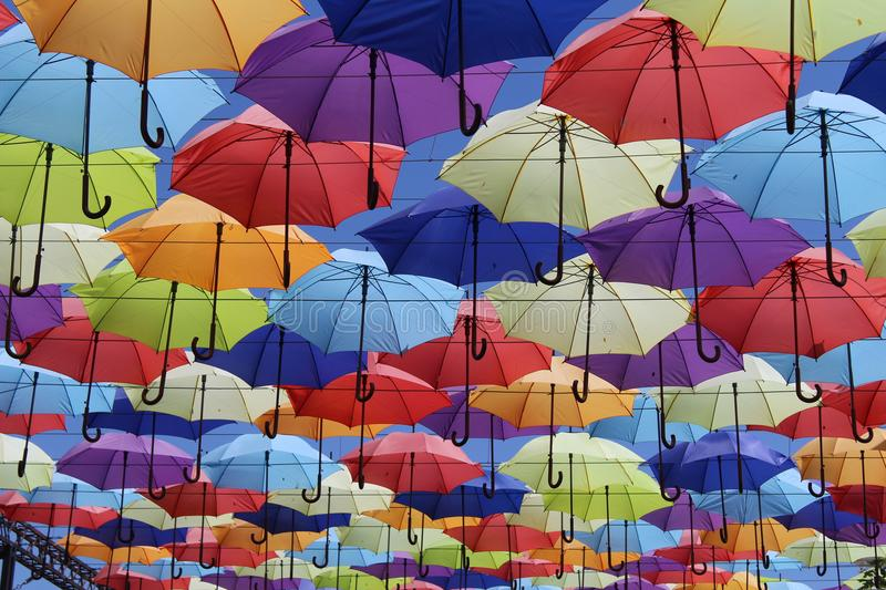 Colorful umbrellas flying in the blue sky. Summer royalty free stock photos