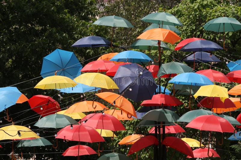 Colorful umbrellas flying in the summer blue sky. stock photography