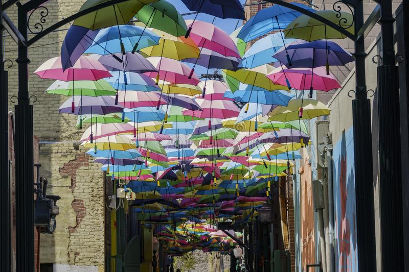 Colorful umbrellas hanging in the famous Orange Street Alley stock images