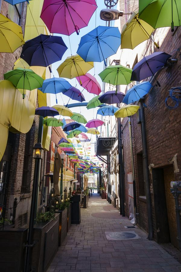 Colorful umbrellas hanging in the famous Orange Street Alley. At Redlands, California stock photography
