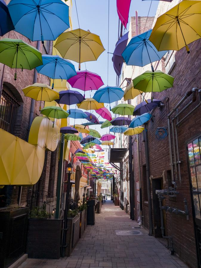 Colorful umbrellas hanging in the famous Orange Street Alley. At Redlands, California stock photos