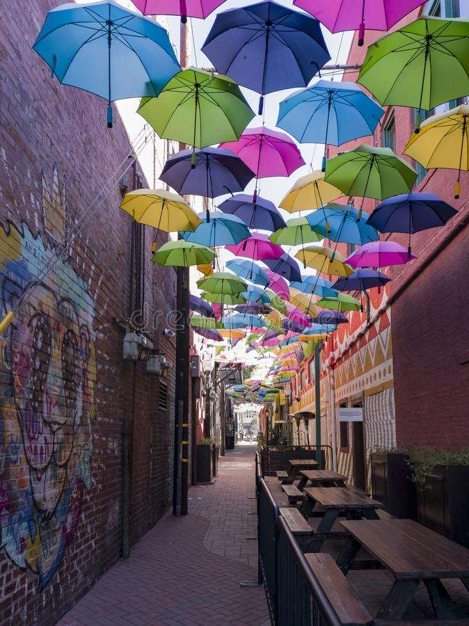 Colorful umbrellas hanging in the famous Orange Street Alley. At Redlands, California stock images