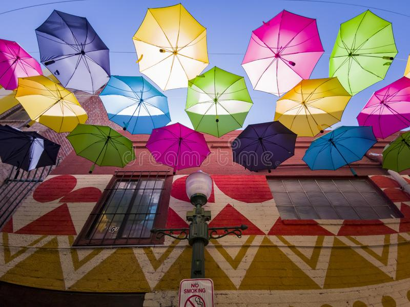 Colorful umbrellas hanging in the famous Orange Street Alley. At Redlands, California royalty free stock image