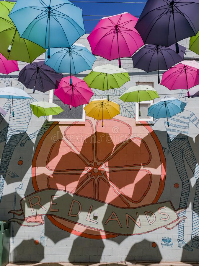 Colorful umbrellas hanging in the famous Orange Street Alley. At Redlands, California royalty free stock photography