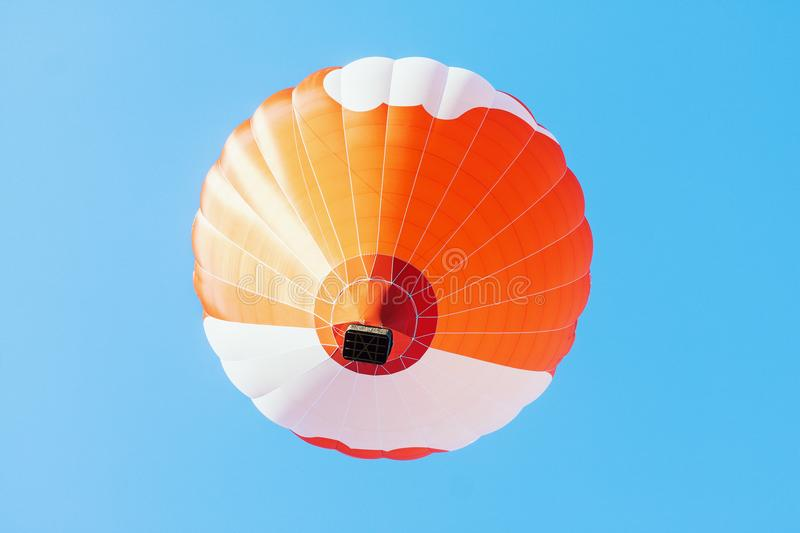 Colorful unbranded hot-air balloon flying royalty free stock images