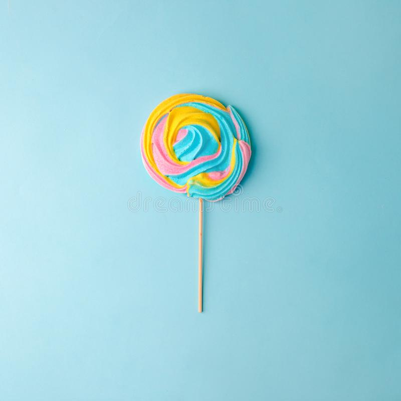 Free Colorful Unicorn Rainbow Color Meringue Lollipop Candy On Pale On Blue Background. Flat Lay. Summer Sweet Minimal Concept Royalty Free Stock Photo - 155833515