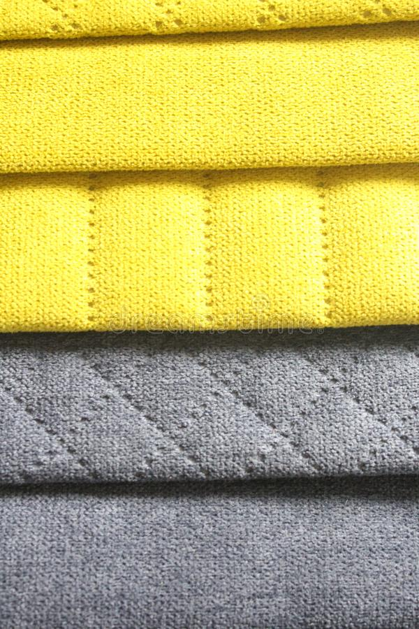 Colorful upholstery fabric samples. Close-up of samples of furniture fabric. Yellow and grey fabric with stitch effect. Furniture. Industry. Background texture stock image