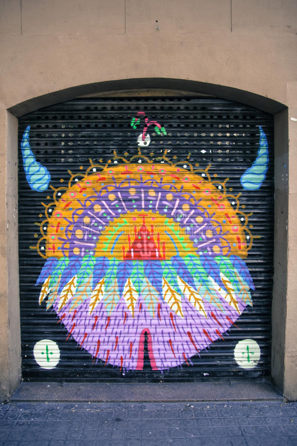 Colorful urban art graffiti on garage door royalty free stock images