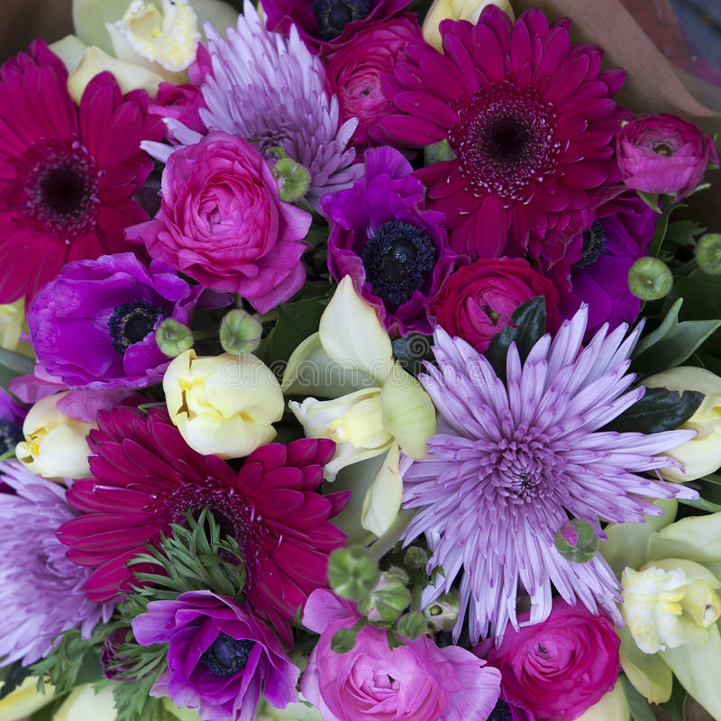 Colorful variety of flowers. In iron trolley selling in the market in London stock image