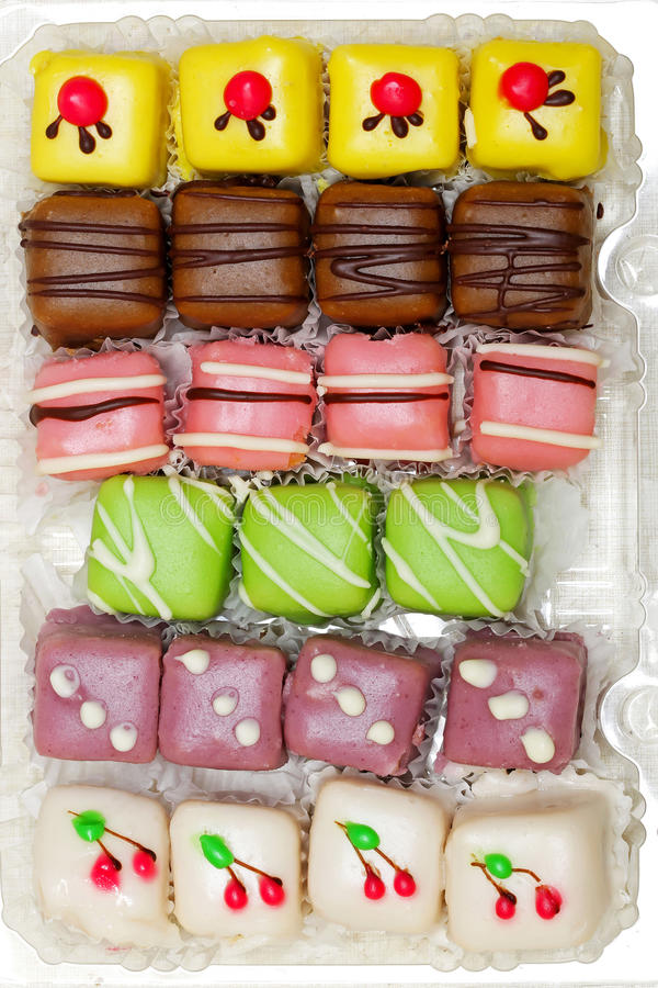Mignon cakes. Colorful variety of mignon cakes in the box stock image