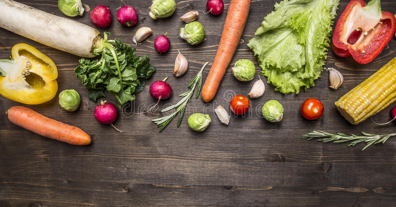 Colorful various of organic farm vegetables Ingredients for cooking vegetarian food on wooden rustic background top view border ,w. Colorful various of organic stock image