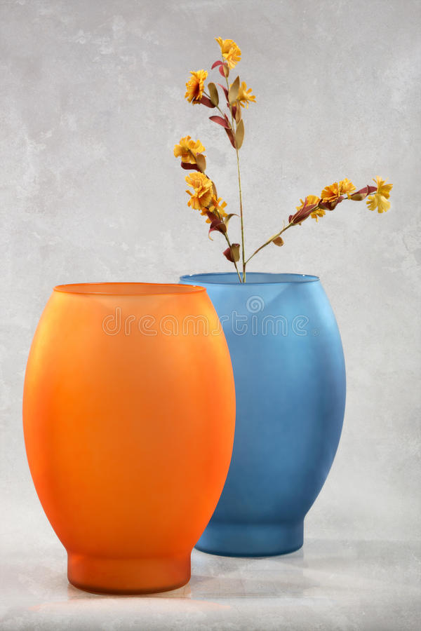 Colorful vases and flowers royalty free stock photo