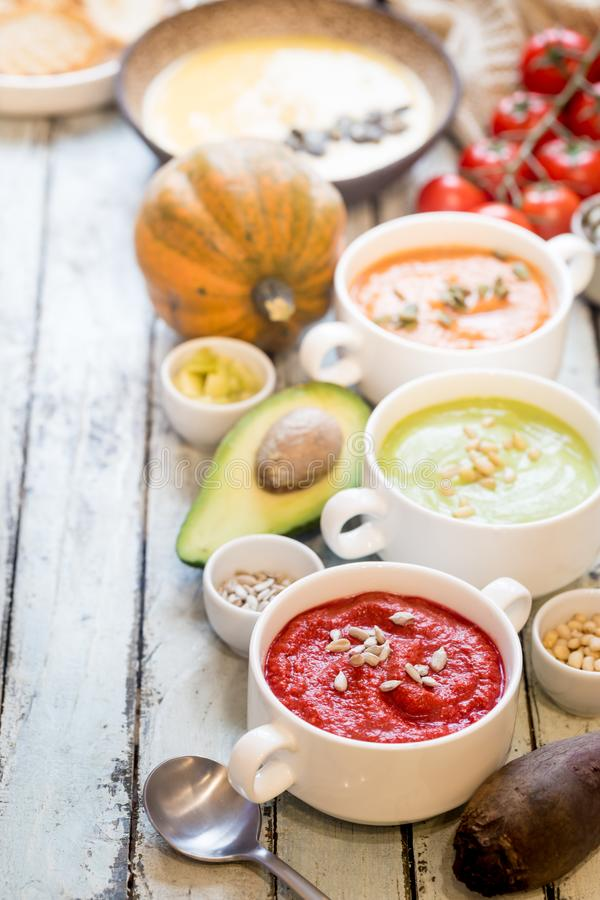 Colorful vegetable cream soups stock photo