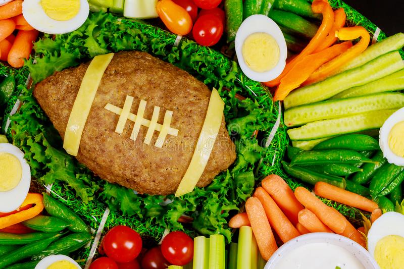 Colorful vegetable platter with meatloaf like a football for Super Bowl party. Colorful vegetable platter with egg and meatloaf like a football for Super Bowl royalty free stock photos