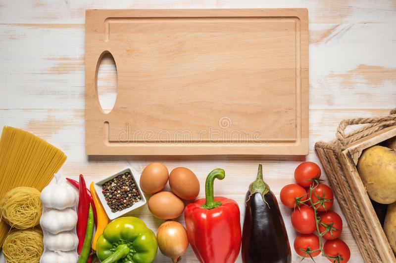 Colorful vegetables and spaghetti on wooden background with copy space.  stock image