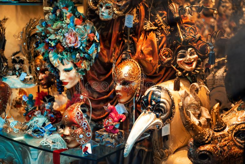 Colorful venetian masquerade masks in shop window in Venice, Italy. Traditional part of famous festival Venetian carnival and. Which takes place every year in royalty free stock photography