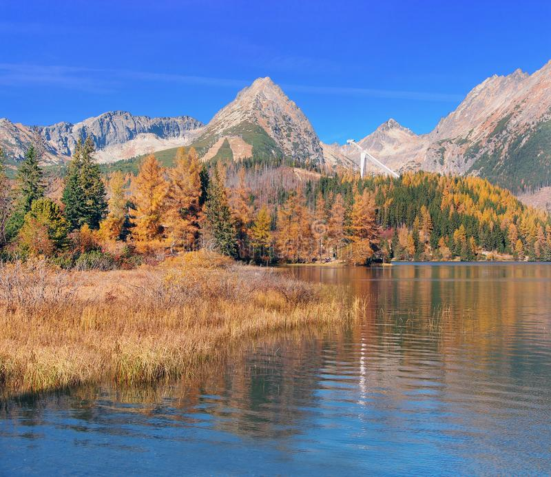 Colorful view of Strbske Pleso and ski jump royalty free stock photography