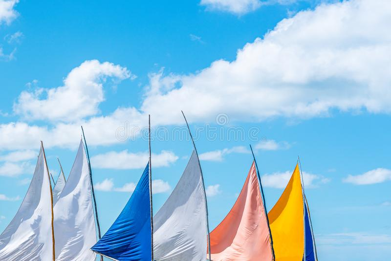Colorful view of the tops of sailing boats in a beautiful blue sky day on the beach. Colorful view of the tops of sailing boats in a beautiful blue sky summer stock photography
