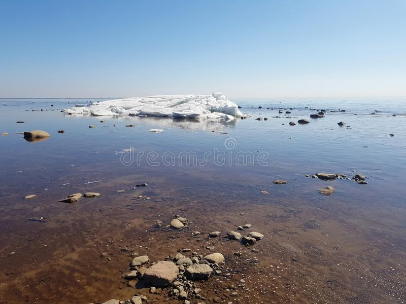 Colorful view of the white iceberg in the Bay, blue sky and clear water on a Sunny cloudless day royalty free stock photography