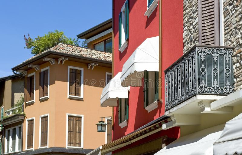 The colorful villages on the Garda Lake. Italy,Garda lake, Sirmione, the colorful houses of the village stock image