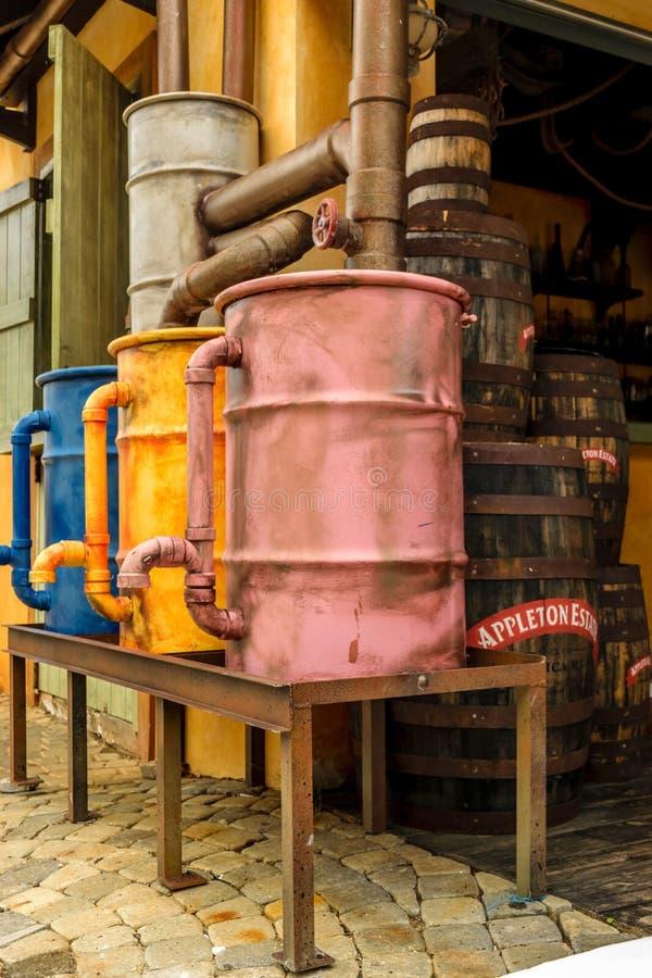 Colorful vintage copper stills and rum barrels. Falmouth, Jamaica - June 03 2015: Colorful vintage copper stills and rum barrels at the Appleton Estate Rum stock image