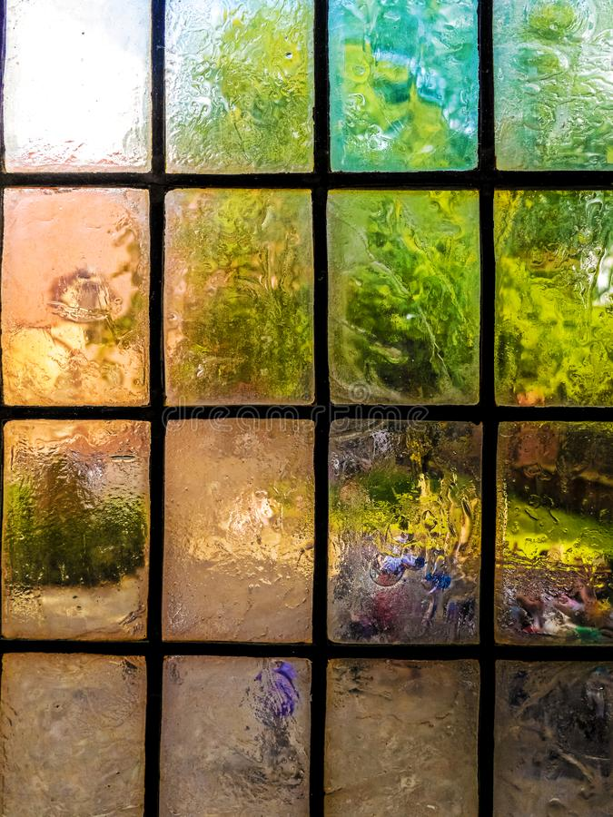 Colorful vintage glazing window panes. Closeup of colorful vintage muntin semitranslucent window panes stock photography
